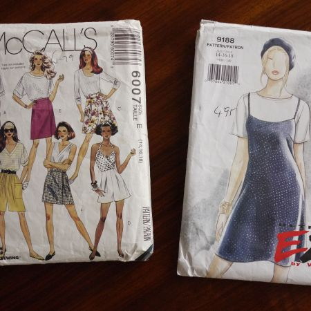 Photo of two pattern envelopes, McCalls 6007 and Vogue 9188.