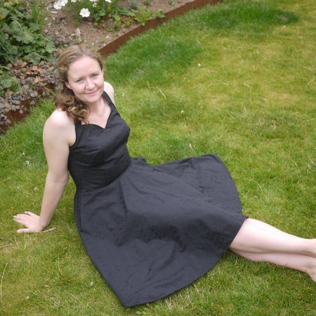 Me sitting on the lawn wearing my black sundress