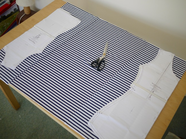 Two pattern pieces laid out on twice folded fabric