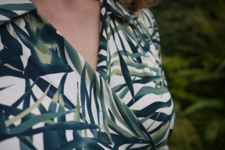 Picture of neckline and collar of leaf-print wrap dress.