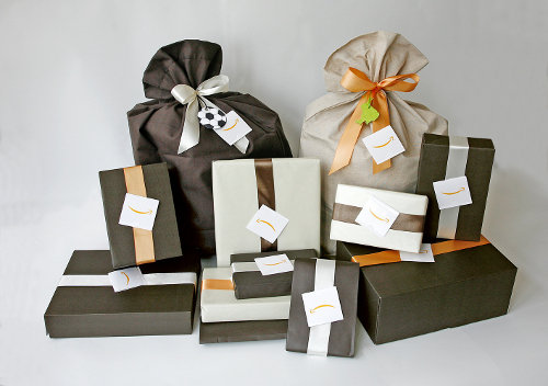 Gift wrapped presents in paper and bags.