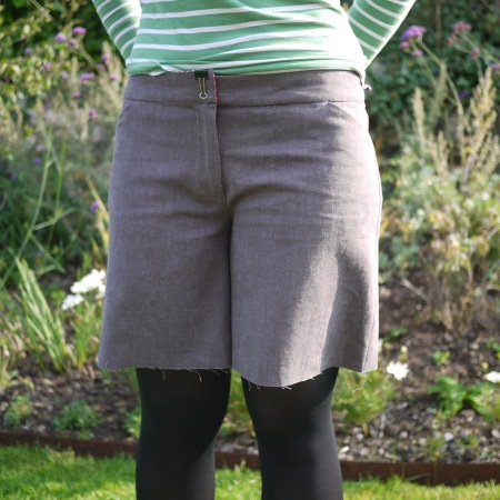 Front view of brown linen shorts, unheeded