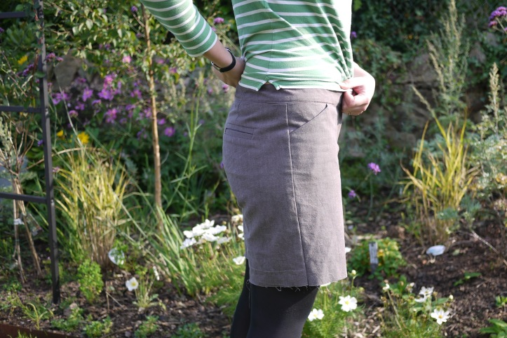 Side view of brown linen shorts