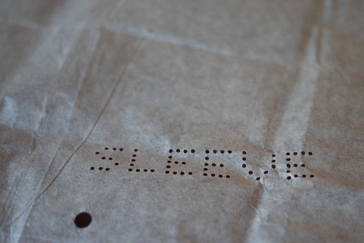 Close-up of the word 'sleeve' punched in a pattern piece