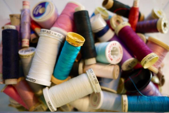 coloured threads in a box