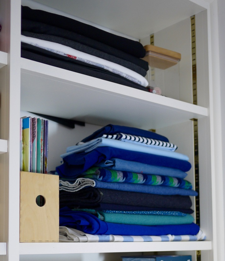 Fabric stacked on open shelves