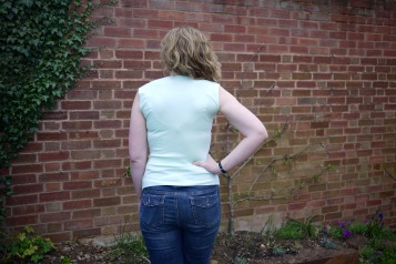 Janet facing away from the camera wearing another mint green T-shirt
