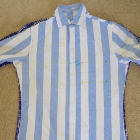 Two blue striped and checked shirts laid one on top of the other to compare size
