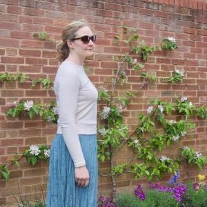 Cream flecked sweatshirt worn with mint green pleated lace skirt